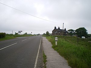A53 road - Image: The Stake Gutter milepost in its setting geograph.org.uk 1381411