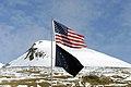 The United States flag flies above the Alaska State flag at the Kodiak Launch Complex in Kodiak Alaska. The 114th Combat Communications Squadron (CBCS), Patrick AFB, Florida, along - DPLA - 69356cad07c8f3850c1f6b3ec479300f.jpeg