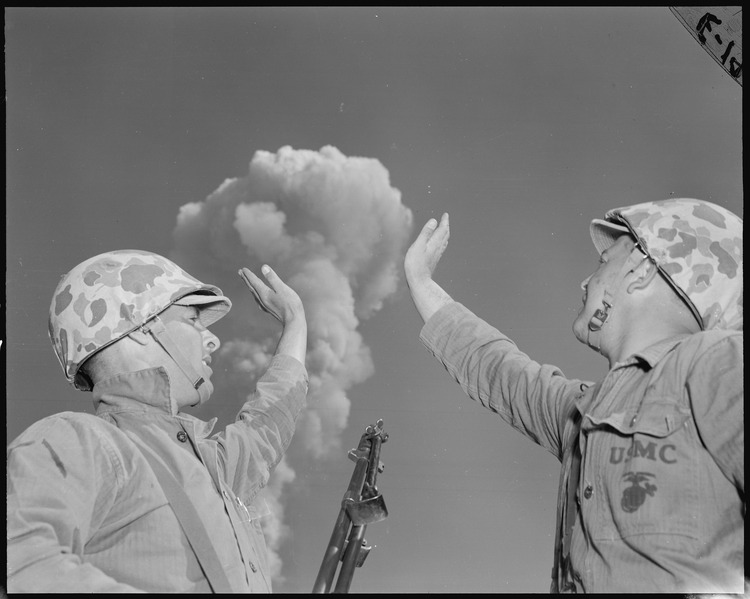 File:The atomic cloud formed by the detonation seems close enough to touch, and tension gone, Poth and Wilson do a little... - NARA - 532467.tif