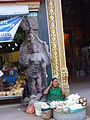 The flower woman who talking in mobile under the gopuram.jpg