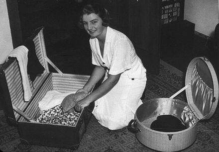 Thelma Coyne packing for her overseas tour in 1938 as a member of the Australian Women's Tennis Team. Thelma Coyne 1938.jpg