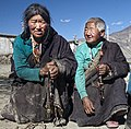 Tibetan Buddhist women in chuba with prayer beads in Tibet, 2010 (cropped).jpg