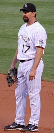 Todd Helton standing on the infield, looking left and wearing a baseball glove