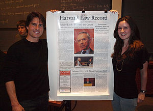 Harvard Law Record - Actor Tom Cruise poses with a poster of the Record front page and with Record editor Jessica Corsi during a visit to Harvard Law School on October 5, 2009