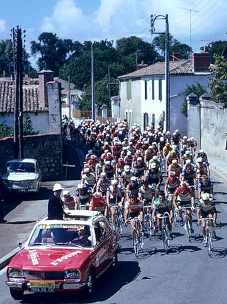 1970 Tour de France - The race director's car and peloton at the start of stage two in La Rochelle