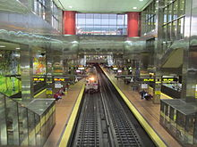 Train emerging from the Center City Commuter Connection at the Market East Station, Philadelphia PA.jpg