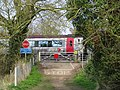 Train on the level crossing near the Oxford Canal - geograph.org.uk - 1804420.jpg