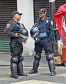 Two Mexico City police officers chatting in riot gear.jpg
