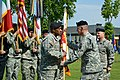 U.S. Army Gen. David M. Rodriguez, second from right, the commanding general of U.S. Africa Command passes the guidon to Maj. Gen. Darryl A. Williams, center, the incoming commanding general of U.S. Army Africa 140603-A-JM436-232.jpg
