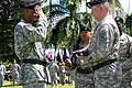 U.S. Army Gen. Vincent K. Brooks, left, the commanding general of the U.S. Army Pacific (USARPAC) salutes as the retirement flag is being presented to Maj. Gen. William Beard, the deputy commanding general 140902-A-RV513-025.jpg