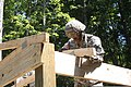 U.S. Army Spc. Chris Edwards, 1194th Engineer Company, Ohio Army National Guard, places a roofing truss during Homeland Response Force at the Camp Ravenna Joint Maneuver Training Center in northeast Ohio 130723-A-EU423-035.jpg