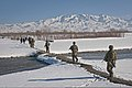 U.S. Army scouts from Headquarters and Headquarters Company, 3rd Battalion, 509th Infantry Regiment, Task Force Spartan, patrol the outskirts of the city of Gardez behind a unit of local Afghan Uniformed Police 120216-A-ZU930-013.jpg