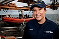 U.S. Coast Guard Seaman Laura Roesch, a deck hand aboard the maritime security cutter USCGC Bertholf (WMSL 750), poses for a photo beside an MH-65 Dolphin helicopter assigned to Air Station Los Angeles Sept 120915-G-ZZ999-001.jpg