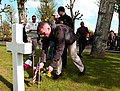 U.S. Marines assigned to U.S. Marine Corps Forces Europe place flowers and flags on graves at the Aisne-Marne American Cemetery and Memorial in Belleau, France, May 25, 2013, in preparation for Memorial Day 130525-M-XI134-009.jpg