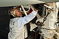 U.S. Navy Aviation Structural Mechanic 1st Class Erika Mata performs a post-flight inspection on an E-2C Hawkeye aircraft assigned to Airborne Early Warning Squadron (VAW) 112 aboard the aircraft carrier USS 111010-N-BT887-464.jpg