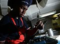 U.S. Navy Culinary Specialist 3rd Class Dre Thompson searches for an icing tip while preparing a cake in the bake shop of the aircraft carrier USS George H.W. Bush (CVN 77) April 24, 2013, in the Atlantic Ocean 130424-N-FU443-148.jpg