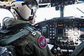 U.S. Navy Lt. Levi Lundell, assigned to Fleet Logistics Support Squadron (VRC) 30 conducts pre-start checks on a C-2A Greyhound aircraft before conducting a functional check flight at Naval Air Station North 130827-N-HF270-043.jpg