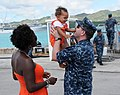 U.S. Navy Lt. Scotty Murphy, assigned to the attack submarine USS Chicago (SSN 721), reunites with his family at Apra Harbor, Guam, April 25, 2013 130425-N-LS794-354.jpg