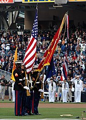 A U.S. Marine color guard dips the U.S. Marine Corps flag for a playing of