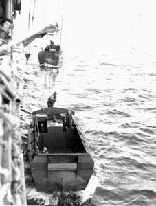 USS-Audubon Lowering-an-LCVP-from-port-davit Feb-1945.png