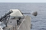 USS Coronado fires a Mark 110 57 mm gun during a live-fire exercise. (35489649510).jpg
