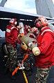 US Navy 020303-N-1587C-083 Loading bombs on aircraft at sea.jpg