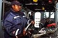 US Navy 030226-N-6077T-001 Helmsman aboard USS Higgins.jpg
