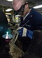 US Navy 040406-N-9630B-074 Hull Technician 3rd Class Robert Randall, of Bealsville, Ohio, uses an oxygen-acetylene torch to braze a deck drain grate in the ship fitter shop aboard USS George Washington (CVN 73).jpg