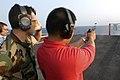 US Navy 040522-N-9742R-001 Aviation Ordnanceman Airman Nathan Quitugua, from Sinajana, Guam, fires a round from a 9mm Beretta pistol.jpg