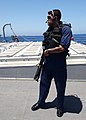 US Navy 040623-N-4374S-012 Yeoman 2nd Class Luis Natermaldonado, assigned to a Visit Board Search and Seizure (VBSS) team, sets a security perimeter during a Maritime Interception Operation.jpg