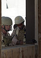 US Navy 041013-N-9693B-002 Steel Worker 1st Class Eric Biwer and Sonar Technician J.J. Gentry, both assigned to Explosive Ordnance Disposal Mobile Unit Four, Detachment Four, perform reconnaissance of a building.jpg