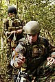 US Navy 050312-N-5781F-006 Aviation Ordnanceman 2nd Class Billy Stocker, assigned to Explosive Ordnance Disposal Mobile Unit Five (EODMU-5), uses available shrubbery to check for trip wires during jungle warfare training exerci.jpg