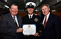 US Navy 050324-N-8148A-029 Rep. Randy Duke Cunningham (R-CA), left, and Bill Irish Driscoll, right, present a certificate of reenlistment to Chief Operations Specialist Jack Thorpe aboard USS Ronald Reagan (CVN 76).jpg