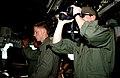 US Navy 050402-N-5526M-006 Lt.j.g. Corry Knopp, right, and Gunners Mate 3rd Class Greg Lawton stand watch on the bridge of the Cyclone-class patrol coastal boat USS Chinook (PC 9).jpg
