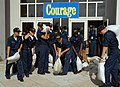 US Navy 050711-N-0388M-010 Students at the Naval Air Technical Training Center on board Naval Air Station (NAS) Pensacola help to clean up debris and remove sandbags from the entrance of the main barracks after Hurricane Dennis.jpg