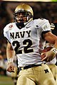 US Navy 051203-N-9693M-522 Navy fullback Adam Ballard (22) crosses the goal line for one of his two touchdowns during the 106th Army vs. Navy Football game.jpg