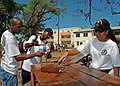 US Navy 060517-N-1161S-019 Sailors assigned to the Nimitz-class aircraft carrier USS George Washington (CVN 73) paint a bench for students at a girls High School during a community relations project in St. John's, Antigua.jpg