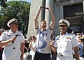 US Navy 060518-N-5390M-002 U.S. Naval Academy Superintendent Vice Adm. Rodney P. Rempt, left, and Commandant Capt. Bruce Grooms, right, congratulate Midshipman 4th Class Brian Richards at the 99th annual Herndon Climb.jpg