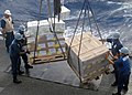US Navy 070207-N-4973A-044 Sailors aboard guided missile destroyer USS O'Kane (DDG 77) unload food stores and refrigerated items during a connected replenishment with Military Sealift Command (MSC) combat stores ship USNS Conco.jpg