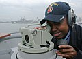 US Navy 070324-N-6710M-006 Quartermaster 3rd Class Florence E. Mays takes bearing readings as dock landing ship USS Tortuga (LSD 46) enters the Republic of Korea for exercise Foal Eagle 2007.jpg