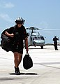 US Navy 070814-N-5240C-030 Naval Air Station (NAS) Key West Rescue Swimmer, Aviation Warfare Systems Operator 2nd Class Kyle Messmer returns to the hangar following the rescue of two kayakers in distress in the waters off Key W.jpg