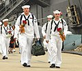 US Navy 080711-N-7869M-076 Sailors assigned to the amphibious transport dock USS Nashville (LPD 14) walk down the pier to greet their families after returning from a deployment.jpg