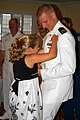 US Navy 080829-N-8629D-058 The daughter of Chief Warrant Officer (CWO) 2 Stephen Ditamore pins wings of gold on her father during a winging ceremony at Naval Air Station Corpus Christi.jpg