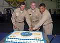 US Navy 081018-N-9988F-001 Cmdr. Ted R. Williams, Capt. Dee L. Mewbourne and Command Master Chief Bryan Exum ut a cake marking the 31st anniversary of the commissioning of the Nimitz class aircraft carrier USS Dwight D. Eisenho.jpg