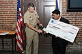 US Navy 081027-N-8637R-001 Rear Adm. Greg Shear, Chief of Civil Engineers and Commander of Naval Facilities Engineering Command, presents a $5,000 check to Eugene Diaz, recipient of the General Services Administration Ida Ustad.jpg