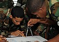 US Navy 090706-N-2651J-007 U.S. Navy special warfare combatant-craft crewmen teach Dominican Republic Navy personnel maritime navigation techniques during a Joint Combined Exchange Training.jpg