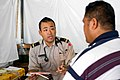 US Navy 090707-N-9689V-005 Japan Maritime Self Defense Force Lt. Kei Mikita consults locals suffering from joint pain or skin conditions at a Pacific Partnership 2009 Medical Civic Action Project.jpg