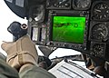 US Navy 090721-N-9950J-547 Marine Capt. Erick Min, assigned to Marine Medium Helicopter Squadron Two Six Two (HMM-262), pilots a CH-53E Sea Stallion helicopter during an in-flight refueling with an Air Force KC-130.jpg