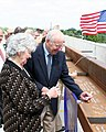 US Navy 090824-N-9876C-013 Retired Navy captain and former astronaut Jim Lovell and his wife, Marilyn Gerlach, sign the final roofing beam to be lifted into place during the topping off ceremony for the Captain James A. Lovell.jpg