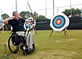 US Navy 091014-N-6326B-122 U.S. Military Summit archery instructor Russell Wolfe, member of the U.S. Paralympic Archery National Team, fires a test shot from his bow.jpg